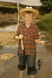 1950s Boy Straw Hat Holding Fishing Pole Wearing Plaid Shirt Blue Jeans
