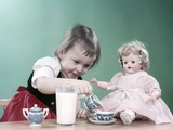 1950s Little Girl and Baby Doll Having Tea Party