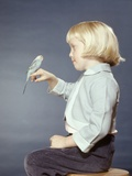 1950s-1960s Girl with Pet Bird Parakeet on Her Finger