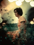 1970s Serious Woman in Field Flowers with Soft Focus Special Effect