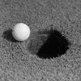 1950s Close-Up of Golf Ball on Green on Very Edge of Cup