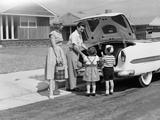 1950s Family Packing Trunk of Car for a Picnic