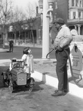1920s Little Girl Standing Beside Her Pedal Car Asking for Gasoline