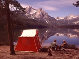 1970ss Elderly Couple Camping Sitting
