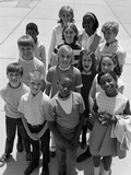 1960s-1970s Overhead of Multi-Ethnic Boy and Girl Students Outdoor