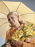 1960s Smiling Blond Woman Umbrella Holding Bouquet Yellow Gladiolas