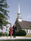 1960s Smiling Family Leaving Church Each Carrying Bible
