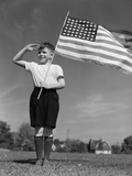 1940s Boy Holding American Flag Saluting Wearing Short Pants