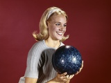 1960s Young Blonde Woman Holding Bowling Ball Wearing Blue Sweater