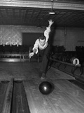 1930s Man Bowling Just Releasing Ball into Alley