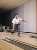1960s Man Bowling Indoor About to Release Ball in Alley