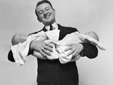 1930s Proud Father Proudly Holding Twin Babies