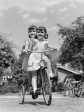 1940s Twin Girls Riding Outside on Tricycle