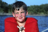 Young Boy Wearing Red Life Preserver