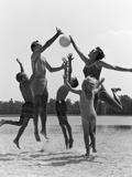 1960s Family Jumping Playing Beach Volleyball
