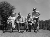 1940s-1950s Foursome of Men Playing Golf Sitting Waiting to Tee-Off