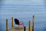 Single Red Painter Metal Chair on End of a Dock Lake George New York USA