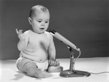 1960s Baby in Diaper Speaking into Microphone
