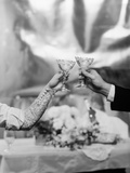 Hands and Arms of a Bride and Groom Toasting with Champagne Glasses