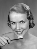 1950s Woman Holding Tooth Brush