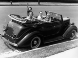 1940s Family of Four in Convertible Ford V-8 Sedan at Camera