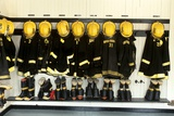 1990s Firefighter Gear Hanging in Firehouse