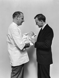 1930s-1940s Man Doctor Showing New Born Infant Baby to Proud Father