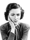 1940s Worried Woman Frowning Holding Hand to Cheek