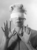 1960s Elderly Woman Wearing Blindfold Holding Up Her Hands