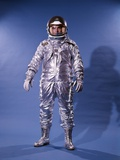 1960's Man in Silver Astronaut Space Suit and Helmet