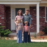 1970s Family Posing on Front Lawn Outside House