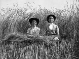 1900 Two Women in Middle of High Wheat Field