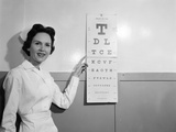 1950s-1960s Woman Nurse Pointing to Eye Chart