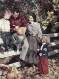 1950s Family Father Mother Son and Daughter Outdoor Carving a Pumpkin