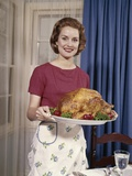 1960s Woman Serving Thanksgiving Turkey Dinner