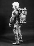 1960s Side View of Astronaut Wearing Helmet NASA Space Suit