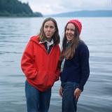 Two Teenaged Girls Standing by Lake