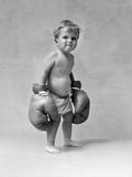 1930s Baby Boy Toddler Wearing Oversize Boxing Gloves