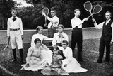 1890s-1900s Men Holding Racquets and Women and One Child in Front of Net on Grass Tennis Court