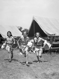 1930s Three Teen Girls Wearing Camp Shorts and Shirts Running from Tents