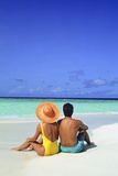 1990s Man and Woman Sitting on the Beach Facing the Water Mopion Island  Grenadines  West Indies