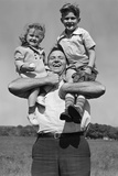 1930s Father Holding Son with Baseball Mitt and Daughter on His Shoulders