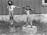 1930s-1940s Boys Playing Carnival Strongman  One Lifting Dumbbells Other Announcing Act