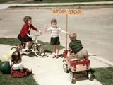 1950s Boys and Girls Outdoor with Tricycle and Wagon Playing Traffic with Police Stop Sign