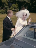 1960s Couple Bride and Groom Getting into Car after Wedding