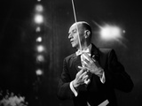 1960s-1970s Portrait of Man in White Tie and Tails Conducting an Orchestra in Symphony Hall