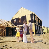 1970s Family in Front of a House under Construction