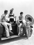 1920s-1930s Man and Three Women in Beach Clothes or Bathing Suits Posing with Car on Running Board