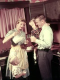 1950s Family in Kitchen Mother Pouring Milk from Pitcher for Dad and Kids
