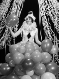 1920s-1930s Young Woman Pierrot Clown Amid Party Balloons and Paper Streamers